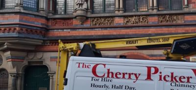 Cherry picker with operator